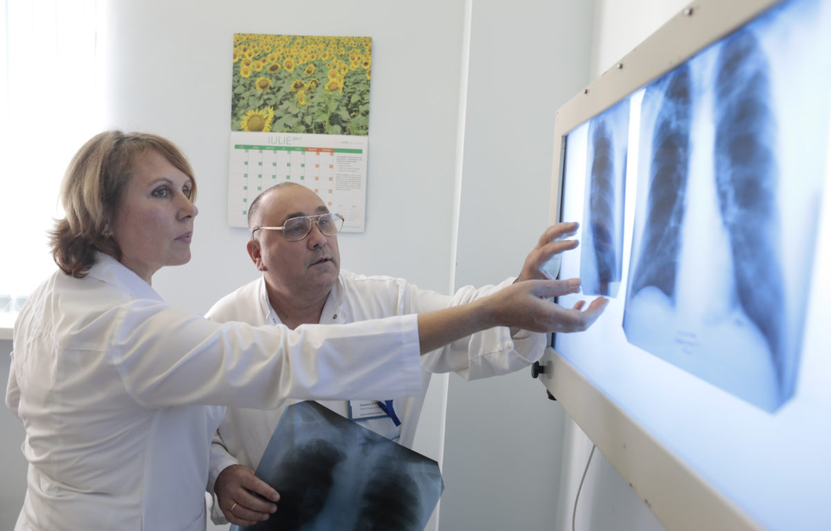 "SVETLANA GHEORGHILAS and DIMITRI POPOV STREAM Physiology Medics during an interview the Institute of Physiopneumology ""Chiril Draganiuc"" during a STREAM trial and TB Treatment on July 2017. Chisinau, Moldava. (Photo/Javier Galeano)"